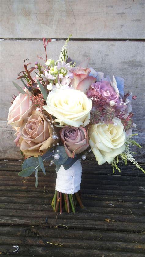 ivory bouquet  mauve bride   white  mauve