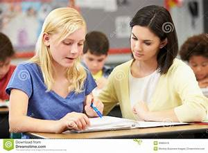 Teacher Reading With Female Pupil In Class Royalty Free ...