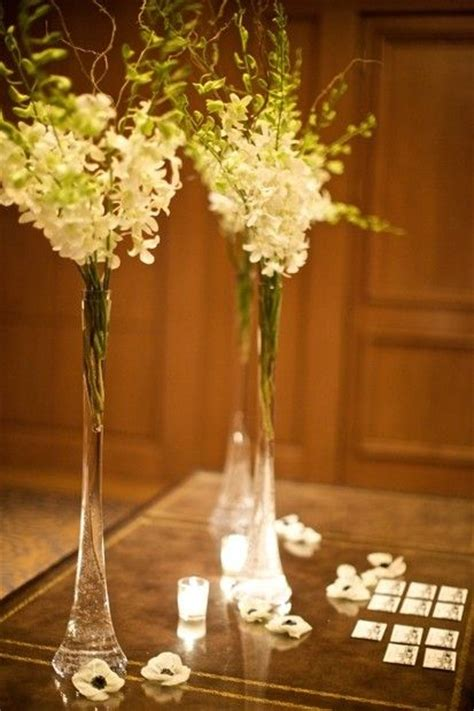 Thin Vase Centerpiece Ideas flower arrangements like these vases better