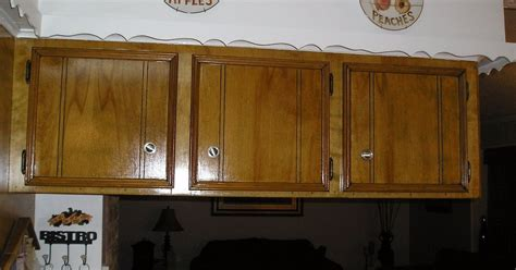 painting over stained cabinets staining kitchen cabinets hometalk