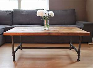 Wood coffee table with steel pipe legs made of reclaimed for Wood top metal legs coffee table