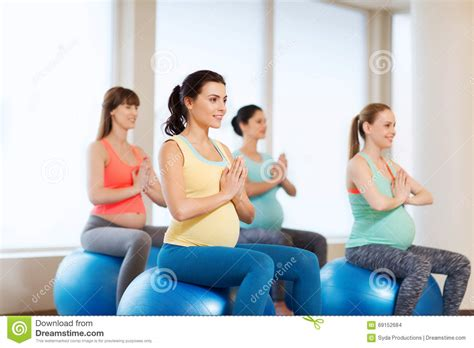pregnant exercising happy gym pregnancy healthy sport lifestyle fitball balance fitness concept woman female