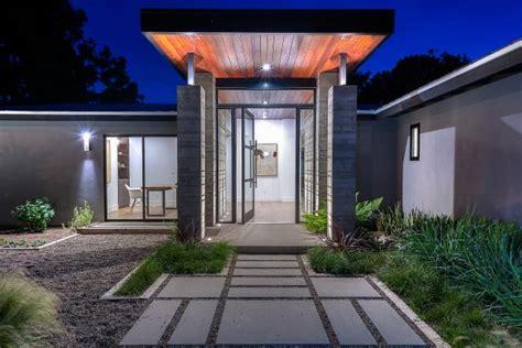 modern ranch style home  concrete paver walkway hgtv