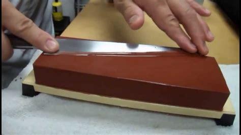 Sharpening Knife On A Whetstone With Master Sushi Chef