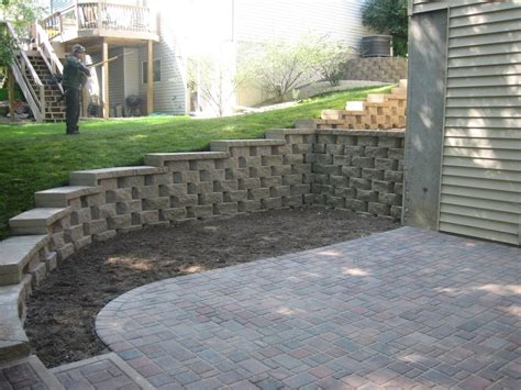 Patio Blocks by Retaining Wall With Caps And A Paver Patio Installed In