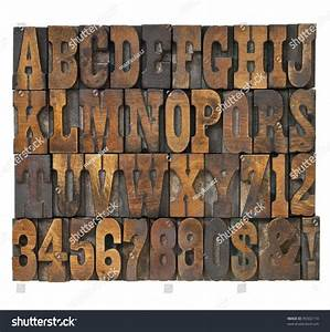 letters and numbers in vintage letterpress wood type With wooden typeset letters