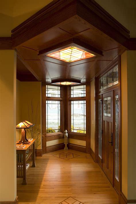 modern prairie style entry foyer  backlit art glass
