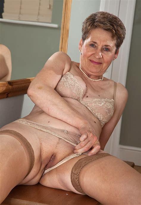 Hot mature ebonies are sucking dicks and posing