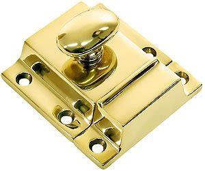 large cast brass cupboard latch  oval turn piece