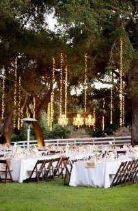 how to hang lights vertically from trees weddingbee