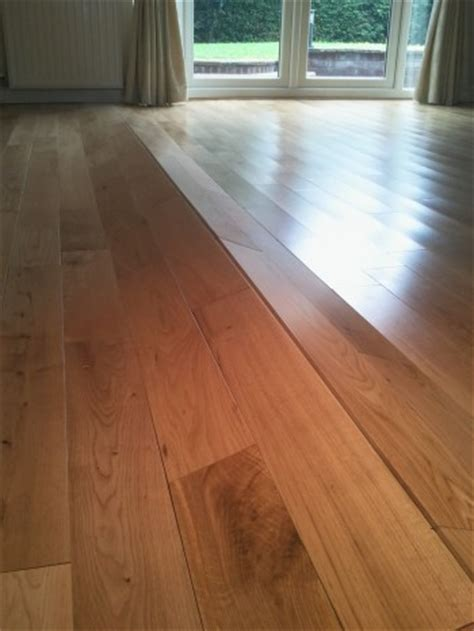 Wood Floor Buckling Up by Why Do Wood Floors Buckle Fitmywoodfloor