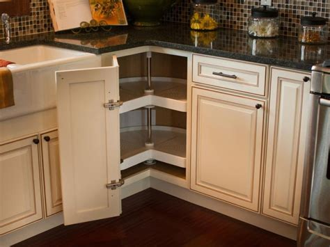 kitchen cabinet refrigerator a corner cabinet door opens to reveal a kidney shaped lazy 2717