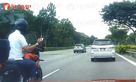 Motorcyclist Points Middle Finger After Trying Cut