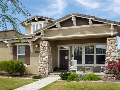 craftsman home  beige stone columns hgtv