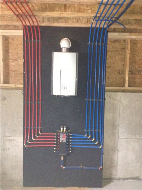 pex radiant floor heating design install of a pex manifold with a rinnai tankless water