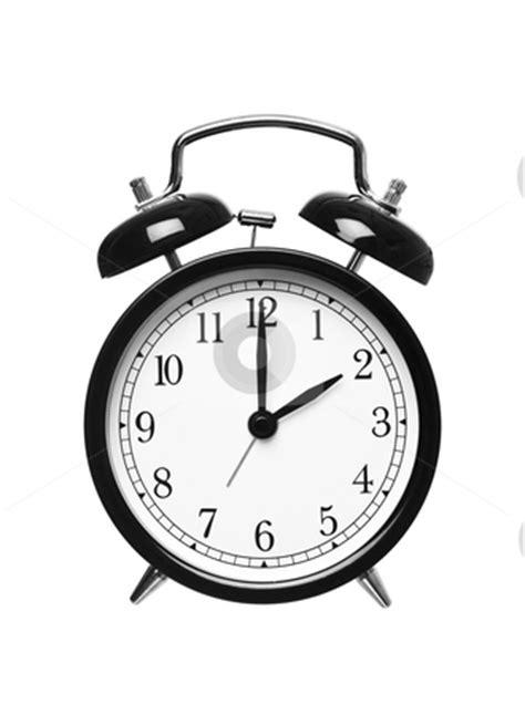 alarm clock shows  oclock stock photo