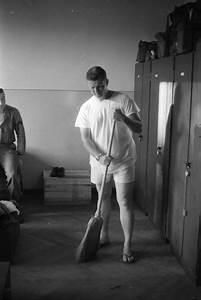Man In Underwear Sweeps The Floor