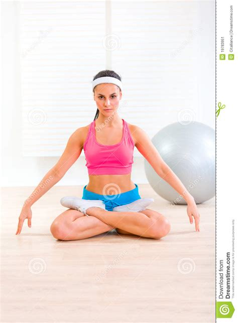 Living Room Floor Exercises by Concentrated Practising Exercises Stock Image