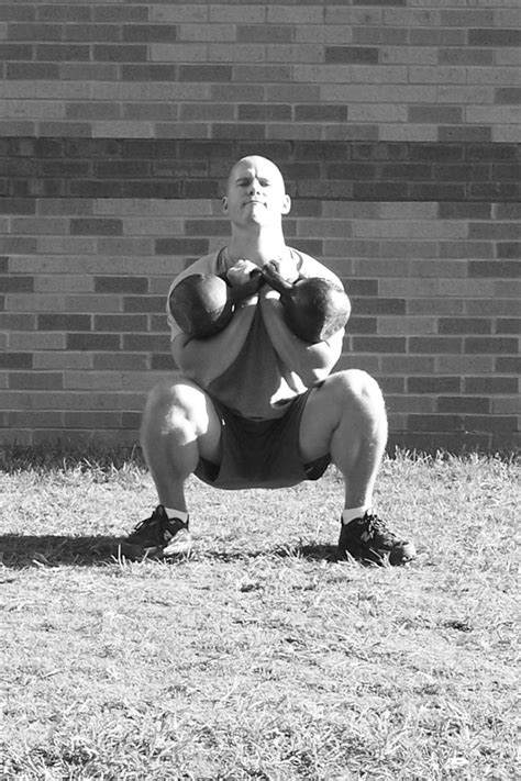 german volume training kettlebell workouts squats kb front workout escalating weight routines