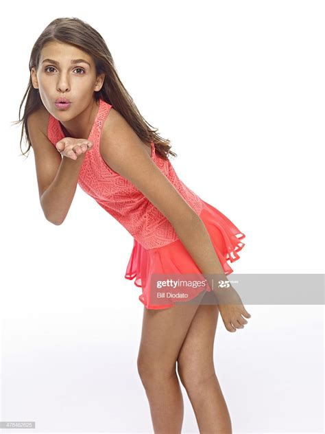 Young Girl Blowing A Kiss In Studio Highres Stock Photo