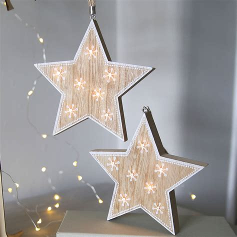 wooden star light hanging decoration by red lilly