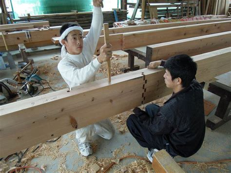 japanese carpenters demonstrate traditional wooden joints
