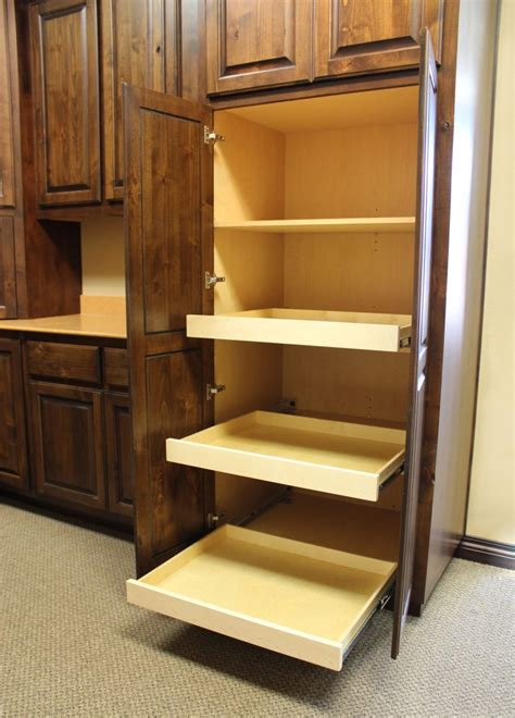 Roll Out Shelves For Kitchen Cabinets by Pull Out Shelves Burrows Cabinets Central