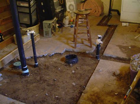 how to make a bathroom in the basement all sewer lines and leveled and covered with dirt time to cement