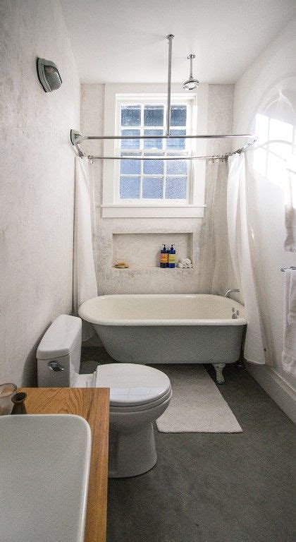 oversized rain shower head   claw foot tub