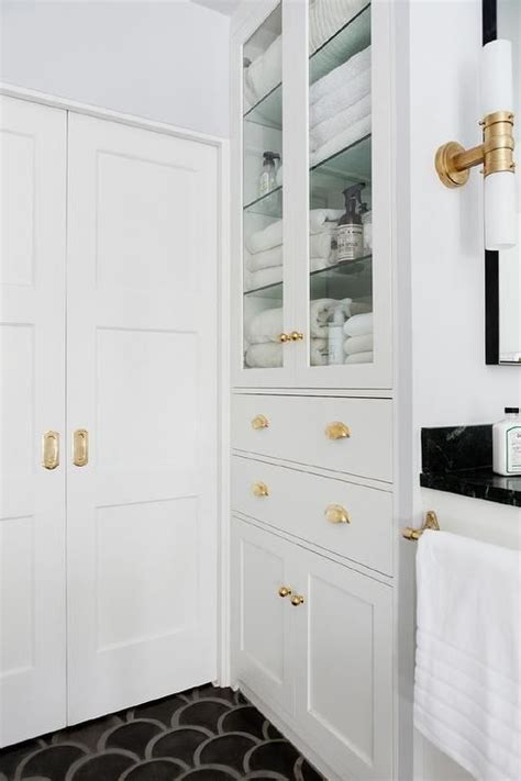 Glass Bathroom Cabinets by Amazing Bathroom Features A Built In Glass Front Linen