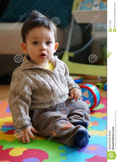 Sitting On The Mat - sitting boy stock photo image 51112525