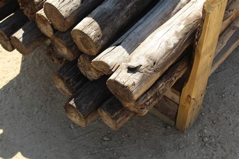 Pallet Lot Of Round Wooden Fence Posts
