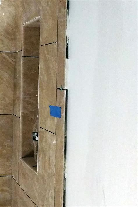 ask the builder dealing with a bungled wall tile