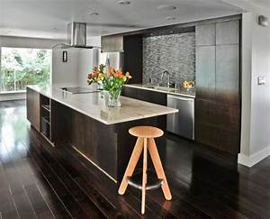 How to use dark floors to brighten your dull home for Wood floors in modern kitchen