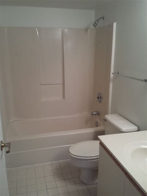 bathroom shower ideas on a budget pls help rescue this almond bathroom from the 80 39 s