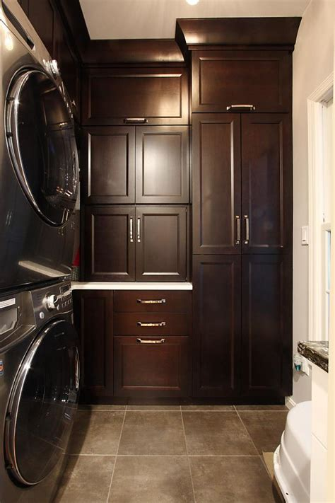 traditional laundry room design  dark wood cabinets
