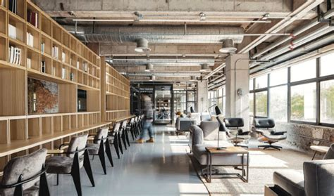 Industrial Office Features Exposed Bricks & Concrete Ceilings