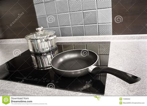 Modern Kitchen Appliances. Pot And Pan On A Cooker Stock