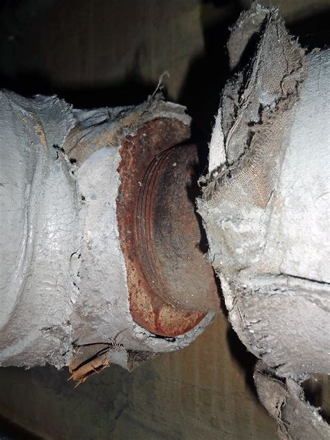 exposed asbestos pipe insulation  pipe fitting