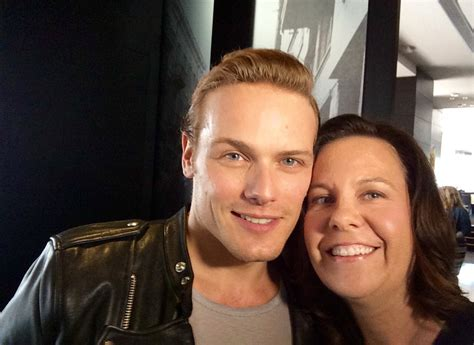 tobias menzies iliad new old picture of sam heughan with a fan at comic con