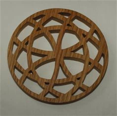 images  wooden trivets  pinterest wooden beads scroll   potholders