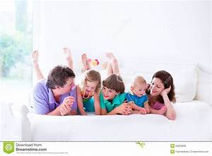 Adorable Young Family With Three Kids In Bedroom Stock ...