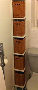 close up of the bathroom shelves with baskets With skinny bathroom shelf