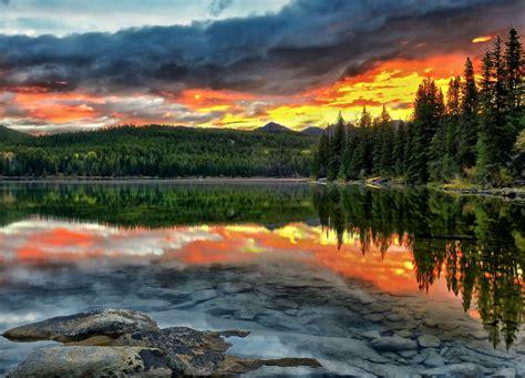 Alberta Canada lake sunset reflection forest bottom
