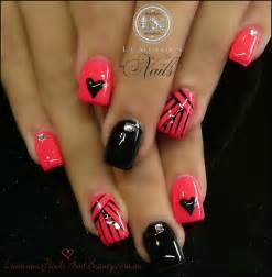 Coral pink black gel nails with hearts stripes
