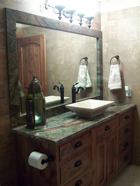 bathroom design  rain forest green granite countertops