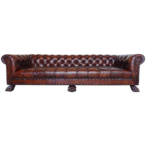 monumental chesterfield leather sofa with nailhead trim at