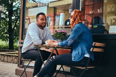 In milwaukee, wisconsin is a historic warehouse space with an open, natural feel for a relaxed wedding. A Couple Dating Drinking Coffee, Sitting Near The Coffee Shop. Outdoors On A Date. Stock Photo ...