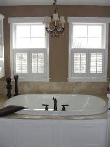 chandeliers above bath tubs