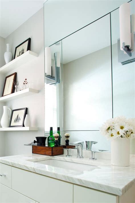 modern white bathroom with mirrors and open shelving hgtv